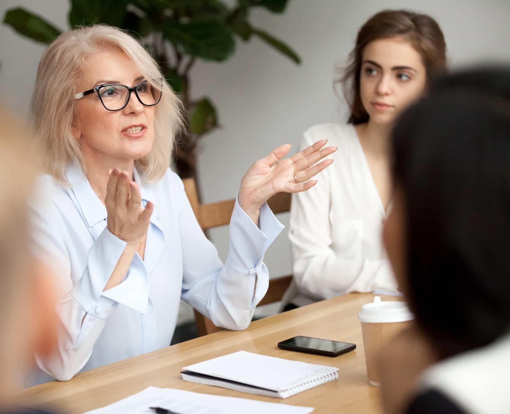 business woman speaking in a work meeting