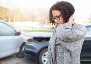 Injured woman feeling bad after having a car crash