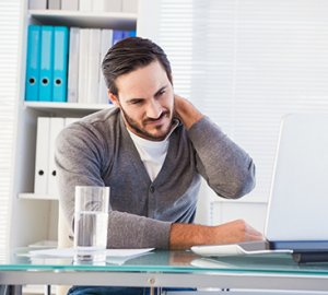 Man at work suffering from neck pain