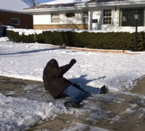 man fallen after slipping on icy walkway