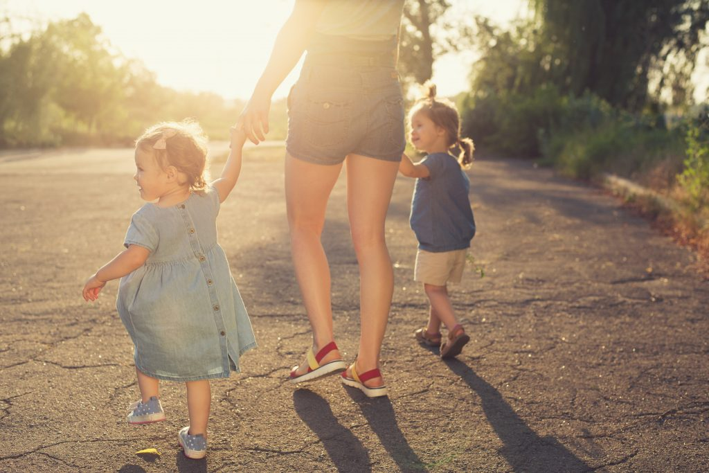 Mother walk with two children