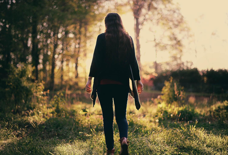 Young woman walking away